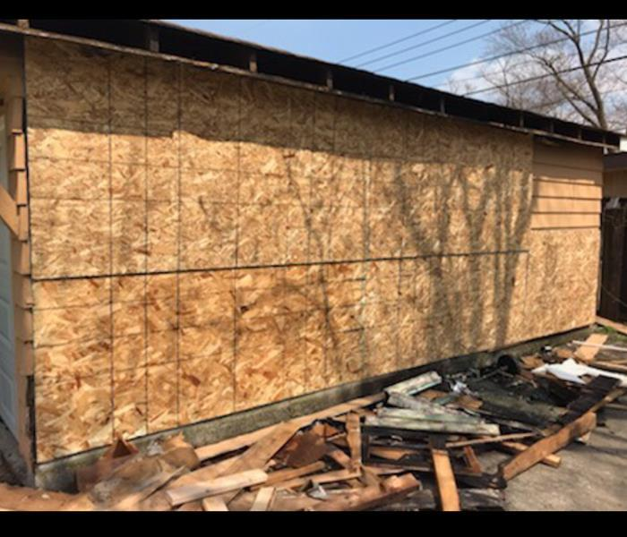 Garage boarded up after fire damage