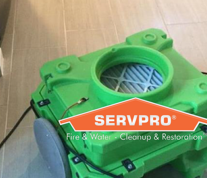 Picture of a green air scrubber with the SERVPRO house logo