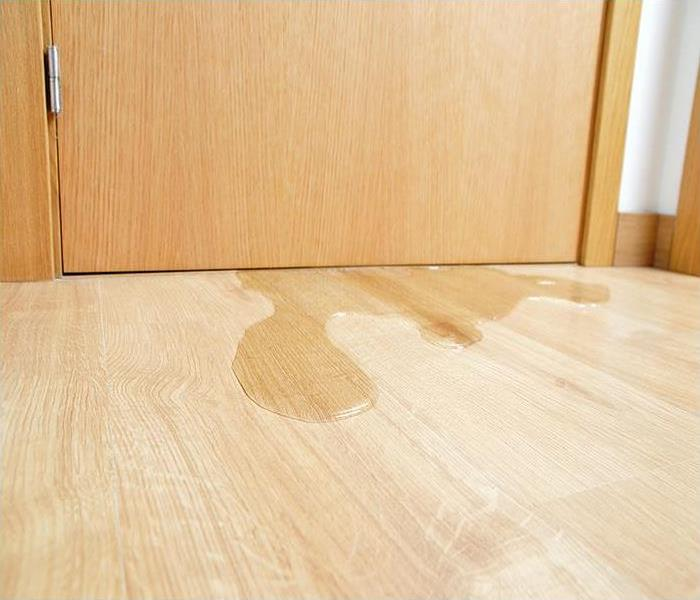 water covering wood flooring after a leak