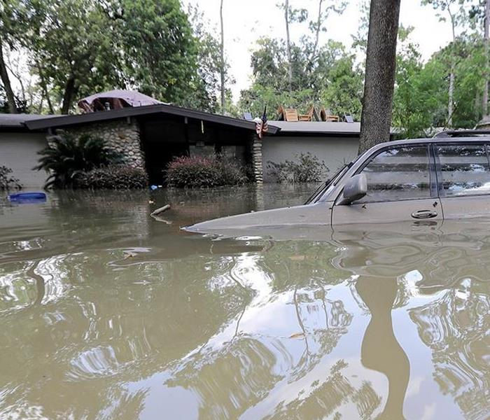 Home and car underwater after Hurricane