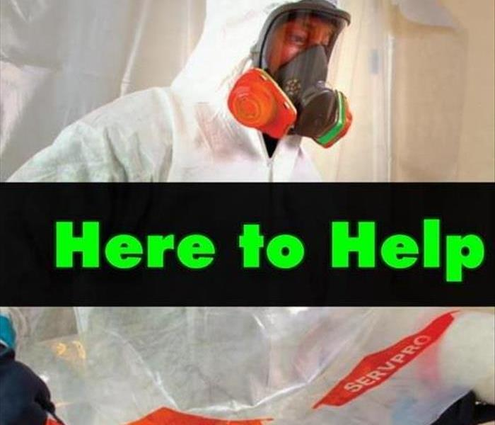 "SERVPRO technician in full PPE with the words ""Here to Help"""